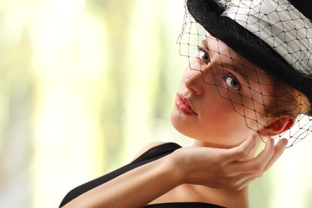 elegant young woman with hat photo