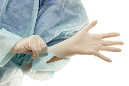 doctor get on gloves sterile isolated on white background  photo