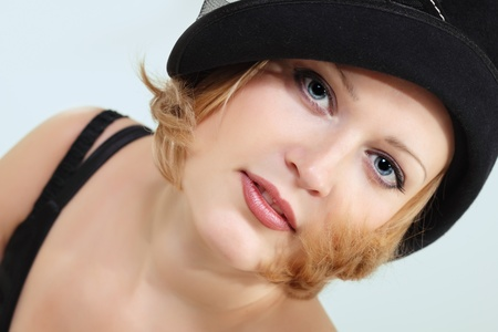 lady charming with black hat over light background photo