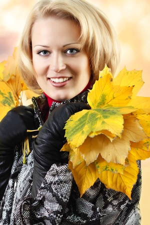 beautiful woman with maple leaves Stock Photo - 8323659