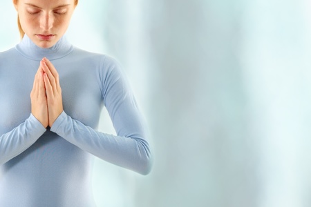 woman meditate over waterfall photo
