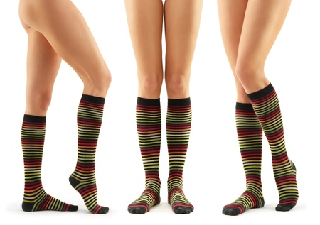 legs long female in striped socks isolated on white background photo