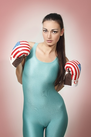 boxing young woman isolated on light red background Stock Photo - 8499329