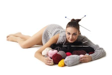 woman finish knitting sweater isolated on white background photo