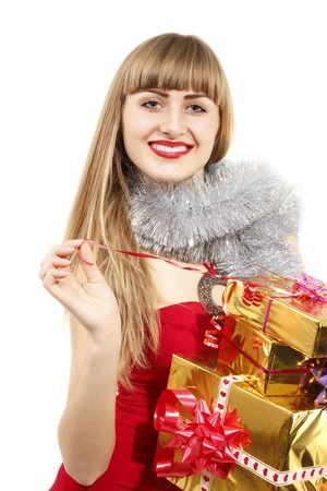 christmas young woman holding golden gifts isolated on white background photo