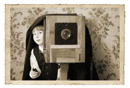 boy retro photographer with vintage camera stylization  photo