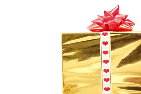 holiday gift in box with gold foil and red bow isolated on white background Stock Photo - 8577994
