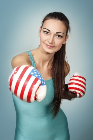 boxing young woman over blue background photo
