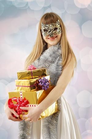 christmas masquerade girl with cat mask isolated on white background photo