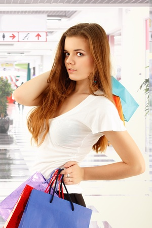 shopping teen girl smiling holding bags in store Stock Photo - 8662734