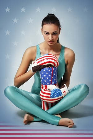 boxing young woman over usa background photo