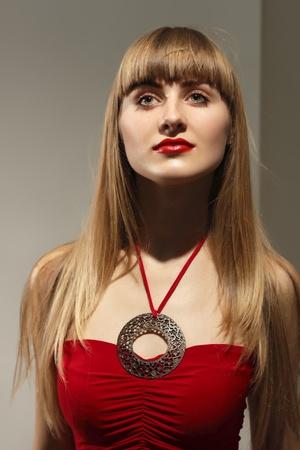 fashion beautiful woman with red dress and lipstick  studio shot photo