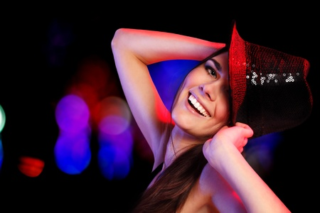 dancing party girl happy young attractive in nightclub photo