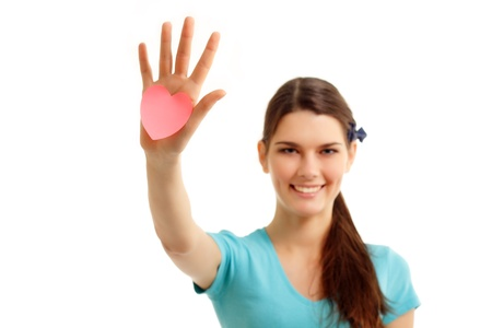 happy teen girl holding in hand heart love symbol valentine isolated on white background Stock Photo - 8819872