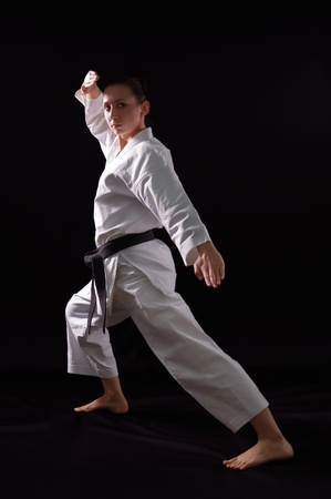 karate woman champion of the world on black background studio shot Stock Photo - 8936297