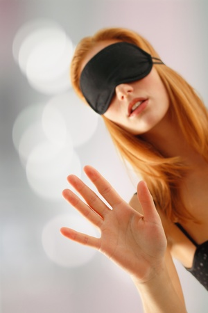 unsighted: girl with bandage over boke background