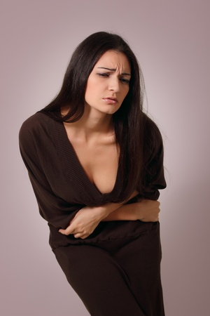 woman with menstrual belly pain photo