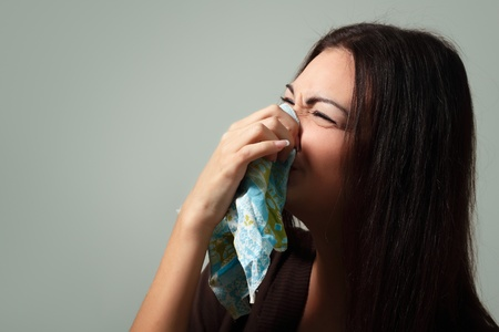 woman flu with cold in head blows nose Stock Photo - 9068533