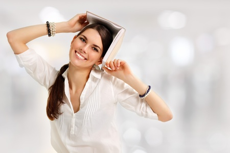 student girl cheerful with books Stock Photo - 9352885
