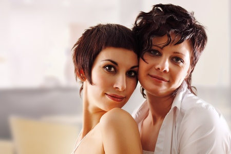 women couple happy attractive at home photo