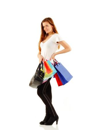 shopping teen girl smiling holding bags full-length isolated on white background photo