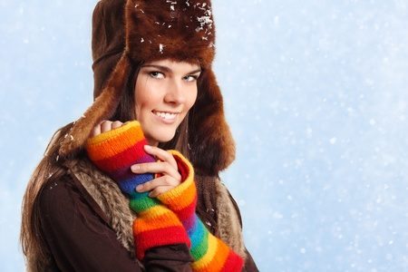 teennager girl pretty smiling on winter snow blue background Stock Photo - 9383915