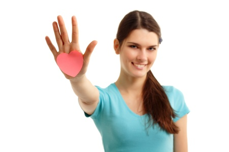 happy teen girl holding in hand heart love symbol valentine isolated on white background Stock Photo - 9383908