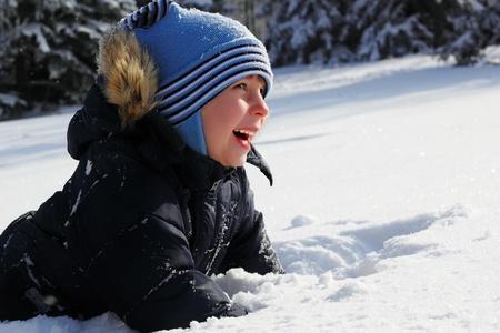froze: little boy happy have fun snow winter outdoor Stock Photo