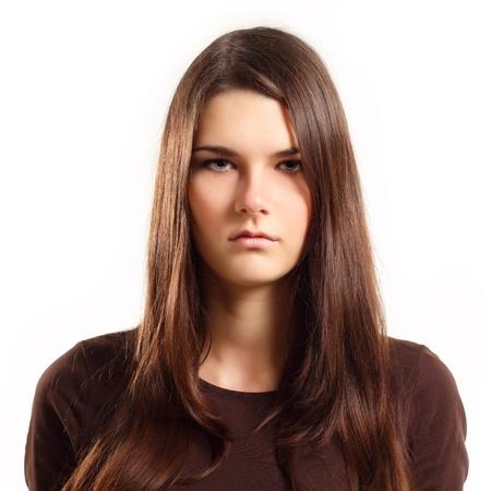 gestos de la cara: chica adolescente con expresi�n facial en blanco aislada sobre fondo blanco