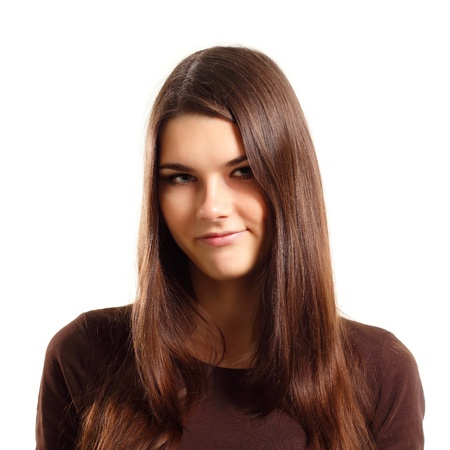 sceptic: attracive teen girl makes a grimace displeased isolated on white background Stock Photo