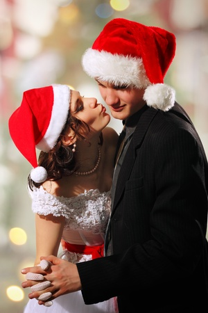 Happy dancing christmas young bride and groom Stock Photo - 10142085