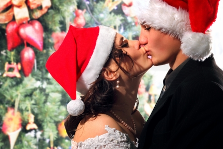 emotional couple: bride and groom happy kissing christmas young