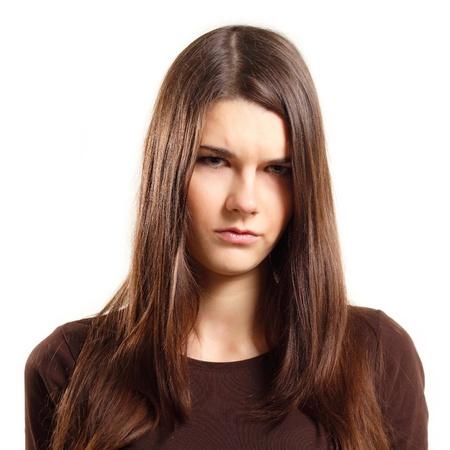 grimace: teenager girl sulks isolated on white background
