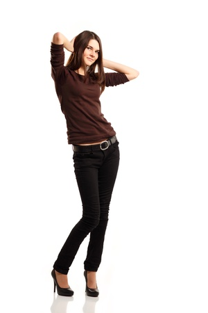 jeans girl: attractive teenager girl friendly full length isolated on white background