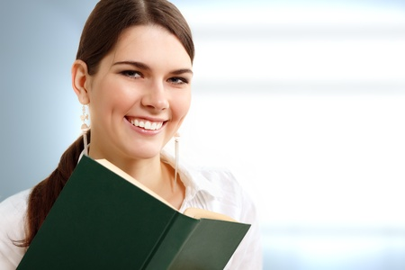 student girl cheerful with book photo