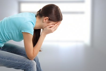 hopelessness: depression teen girl cried lonely in room Stock Photo