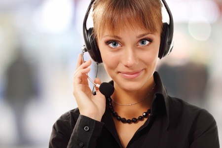Support phone operator beautful young woman in headset at workplace Stock Photo - 10185132