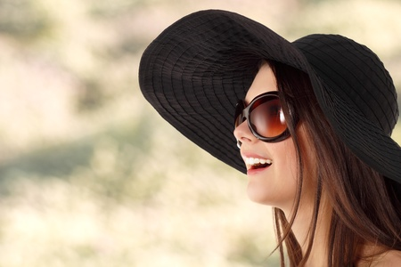 sun shades: summer teen girl cheerful in panama and  sunglasses over nature background Stock Photo