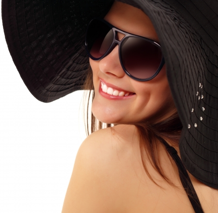 summer teen girl cheerful in panama and  sunglasses enjoying isolated on white background photo