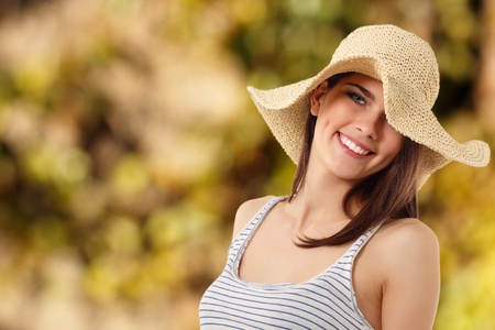 summer teen girl cheerful in straw hat enjoying over nature background Stock Photo - 10387264