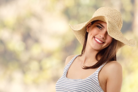 summer teen girl cheerful in straw hat enjoying over nature background photo