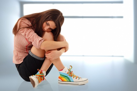 shame: depression teen girl cried lonely in room Stock Photo