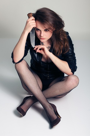 sexy beautiful woman with knife studio shot Stock Photo - 10387268