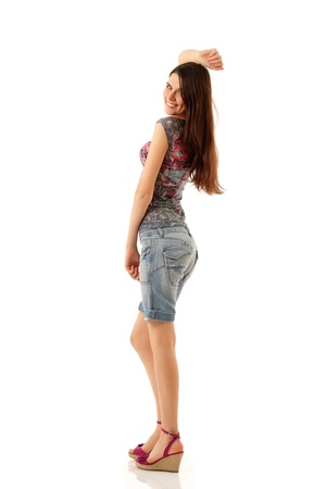 girl in shorts: summer teengirl cheerful full length isolated on white background