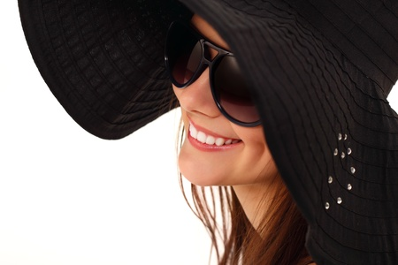 spring teen girl cheerful in panama and  sunglasses enjoying isolated on white background photo