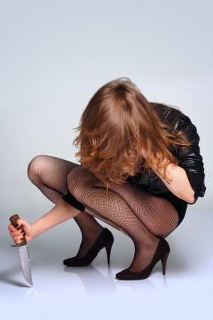 sexy beautiful woman predator with knife studio shot Stock Photo - 10460874