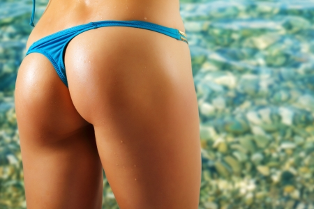 sexy woman buttocks on beach Stock Photo - 10480305