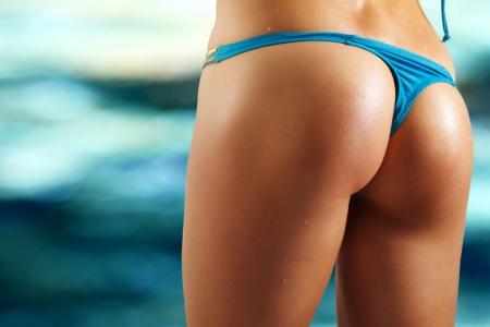 sexy woman buttocks on beach photo