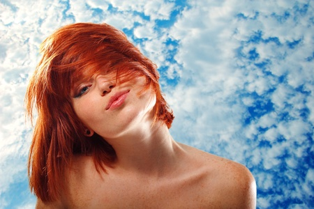 freckles: summer teen girl beautiful freckles redheaded over blue sky
