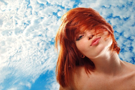 summer teen girl beautiful freckles redheaded over blue sky photo